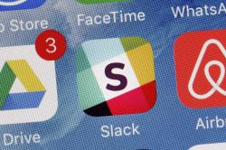 In this Tuesday, Jan. 31, 2017, file photo, the Slack app is displayed on a mobile phone in New York