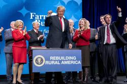 President Donald Trump pumps his fist after signing an executive order and a memorandum on rural broadband access at the American Farm Bureau Federation's Annual Convention at the Gaylord Opryland Resort and Convention Center, Monday, Jan. 8, 2018, in Nashville, Tenn.