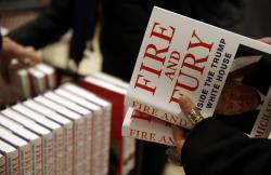 "A customer looks at a copy of Michael Wolff's ""Fire and Fury: Inside the Trump White House."""