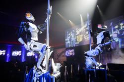 Two pole-dancing robots built by British artist Giles Walker perform at a gentlemen's club Monday, Jan. 8, 2018, in Las Vegas.