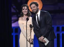 Alison Brie, left, and Sebastian Stan present the award for best action movie at the 23rd annual Critics' Choice Awards.