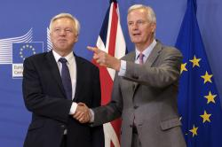 A Monday July 17, 2017 file photo of EU chief Brexit negotiator Michel Barnier, right, welcoming British Secretary of State, David Davis, for a meeting at the EU headquarters in Brussels
