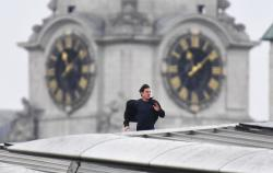 Tom Cruise runs along the rooftop of Blackfriars station, during filming for the new Mission Impossible 6 film, in London.