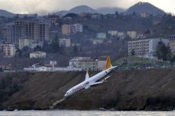A Boeing 737-800 of Turkey's Pegasus Airlines after skidding off the runway downhill towards the sea at the airport in Trabzon, Turkey, Sunday, Jan. 14, 2018.