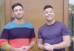 Jwan Yosef, left, with Ricky Martin, right