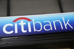 In this Jan. 15, 2015, file photo, a Citibank sign hangs above a branch office in New York