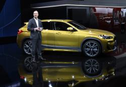 Bernhard Kuhnt, president & CEO, BMW of North America, introduces the first BMW X2 at the North American International Auto Show, Monday, Jan. 15, 2018, in Detroit.