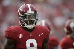 In this Saturday, Sept. 16, 2017 file photo, Alabama running back Bo Scarbrough walks on the field before an NCAA college football game in Tuscaloosa, Ala.