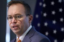 In this Monday, Nov. 27, 2017, file photo, Mick Mulvaney speaks during a news conference after his first day as acting director of the Consumer Financial Protection Bureau in Washington