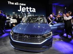 Following a press conference, members of the media photograph the 2019 Volkswagen Jetta at the North American International Auto Show Sunday, Jan. 14, 2018, in Detroit