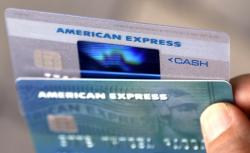 In this Monday, July 18, 2016, file photo, American Express credit cards are photographed in North Andover, Mass. On Thursday, Jan. 18, 2018