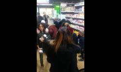 In this image taken from video a customer carries away pots of Nutella the chocolate and hazelnut spread, as others congregate around display of the product in a supermarket in Toulon southern France on Thursday Jan. 25, 2018