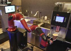 """Robot barista named """"Sawyer"""" makes a coffee at """"Henn-na Cafe,"""" Japanese meaning """"Strange Cafe"""" in Tokyo."""