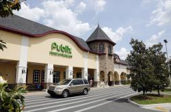 A vehicle passes the front of the Publix supermarket in Zephyrhills, Fla