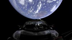 This image from video provided by SpaceX shows the company's spacesuit in Elon Musk's red Tesla sports car which was launched into space during the first test flight of the Falcon Heavy rocket on Tuesday, Feb. 6, 2018