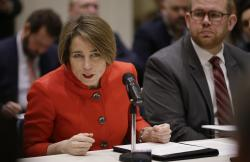 Massachusetts Attorney General Maura Healey testifies before a legislative panel hearing as it considers how Massachusetts might respond after the Federal Communications Commission repealed net neutrality rules at the Massachusetts Statehouse Tuesday, Feb. 6, 2018, in Boston