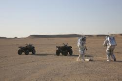 In this Feb. 7, 2018, photo, two scientists test space suits and a geo-radar for use in a future Mars mission in the Dhofar desert of southern Oman