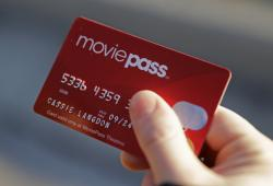 Cassie Langdon holds her MoviePass card outside AMC Indianapolis 17 theatre in Indianapolis.