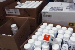 In this Sept. 1, 2004, file photo, medical bottles bearing tracking codes in the McKesson medical distribution center in Delran, N.J.
