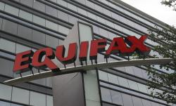 This Saturday, July 21, 201 file, photo shows signage at the corporate headquarters of Equifax Inc. in Atlanta