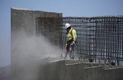 In this May 19, 2017, file photo, a man works on the Southern Nevada portion of U.S. Interstate 11 near Boulder City, Nev.