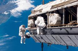 In this Dec. 12, 2006, file photo, made available by NASA, astronaut Robert L. Curbeam Jr., left, and European Space Agency astronaut Christer Fuglesang, participate in a space walk during construction of the International Space Station