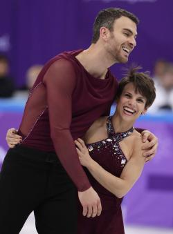 Meagan Duhamel and Eric Radford of Canada react after their performance in the team event pair skating in the Gangneung Ice Arena at the 2018 Winter Olympics.