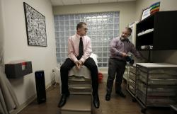 Matt Chappell, left, talks with Dr. Christopher Schiessl during an appointment at a medical center in San Francisco.