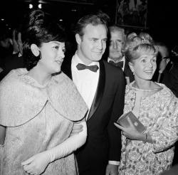 "Marlon Brando, his wife, Mexican actress Movita Castaneda, left, and actress Debbie Reynolds, right, arriving for the West Coast premiere of ""Mutiny on the Bounty"" at the Hollywood Egyptian Theater in Los Angeles in 1962."