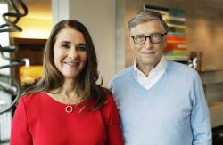 In this Feb. 1, 2018 photo, Microsoft co-founder Bill Gates and his wife Melinda pose for a photo before an interview with The Associated Press in Kirkland, Wash.