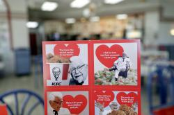 Valentine's Day scratch and sniff cards are seen at a Kentucky Fried Chicken.