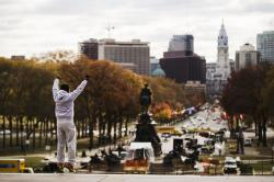 "Alex Carrillo Quito of Ecuador imitates the character Rocky Balboa from the 1976 movie ""Rocky,"" on the steps of the Philadelphia Museum of Art."