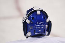 A Bible verse is written on the back of the joint Korean women's ice hockey team goalie Han Dohee's mask during a training session prior to the 2018 Winter Olympics in Gangneung, South Korea.