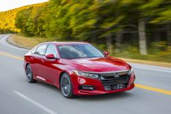 This photo provided by Honda shows the 2018 Honda Accord, a midsize sedan that's available with a manual transmission