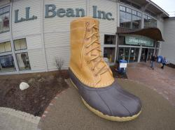 In this March 16, 2016, file photo, shoppers exit the L.L. Bean retail store in Freeport, Maine. L.L. Bean is tightening its generous return policy by imposing a one-year limit on most returns to reduce abuse and fraud
