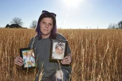 Sarah Sherbert poses for a photo in Anderson, S.C., on Monday, Feb. 5, 2018, holding photos of her children when they were infants