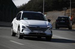In this Monday, Feb. 12, 2018, photo, Hyundai's autonomous fuel cell electric vehicle Nexo is driven along a road near the Pyeongchang Olympic Stadium in Pyeongchang, South Korea