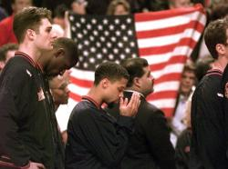 In this March 15, 1996, file photo, Denver Nuggets guard Mahmoud Abdul-Rauf stands with his teammates and prays during the national anthem before the game with the Chicago Bulls in Chicago