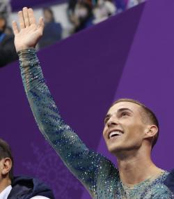Adam Rippon of the United States reacts as his score is posted following his performance in the men's free figure skating final.