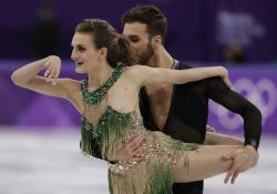 Gabriella Papadakis and Guillaume Cizeron of France perform during the ice dance, short dance figure skating in the Gangneung Ice Arena at the 2018 Winter Olympics.