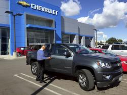 This November 2015 photo provided by Edmunds shows a 2015 Chevrolet Colorado being appraised at a Chevrolet dealership in the Van Nuys neighborhood of Los Angeles