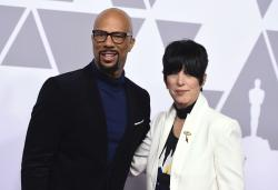 Common, left, and Diane Warren pose at the 90th Academy Awards nominees luncheon.