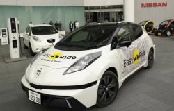 In this Wednesday, Feb. 21, 2018, photo, Nissan Motor Co.'s Easy Ride robo-vehicle starts going from its global headquarters in Yokohama, near Tokyo
