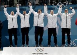Gold medal winners from left: United States' curlers Joe Polo, John Landsteiner, Matt Hamilton, Tyler George, John Shuster and captain Phill Drobnick.