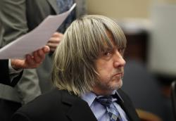In this Jan. 24, 2018 file photo, David Turpin appears in court in Riverside, Calif.