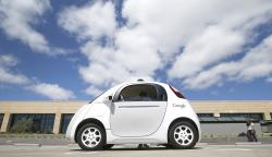 In this May 13, 2015, file photo, Google's new self-driving prototype car is introduced at the Google campus in Mountain View, Calif.