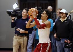 In this Feb. 2, 2018, file photo, Oklahoma guard Trae Young shoots during a team practice in Norman, Okla.