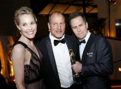 "Leslie Bibb, from left, Woody Harrelson and Sam Rockwell, winner of the award for best performance by an actor in a supporting role for ""Three Billboards Outside Ebbing, Missouri"", attend the Governors Ball after the Oscars."