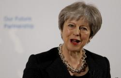 Britain's Prime Minister Theresa May delivers a speech at the Mansion House in London, Friday March 2, 2018