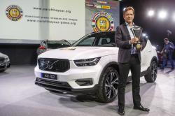 "Hakan Samuelsson, CEO of Volvo Car Group, poses with the winner's trophy next to Volvo XC40 model after it was elected ""Car of the Year 2018"", ahead of the 88th Geneva International Motor Show, at the Palexpo, in Geneva, Switzerland, Monday, March 5, 2018"